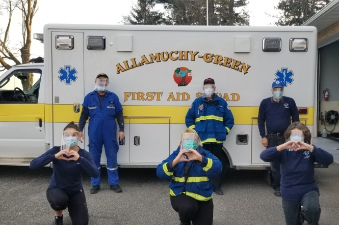 First Responders wearing face shields with holders produced by 3D printers at Centenary Stage Company.